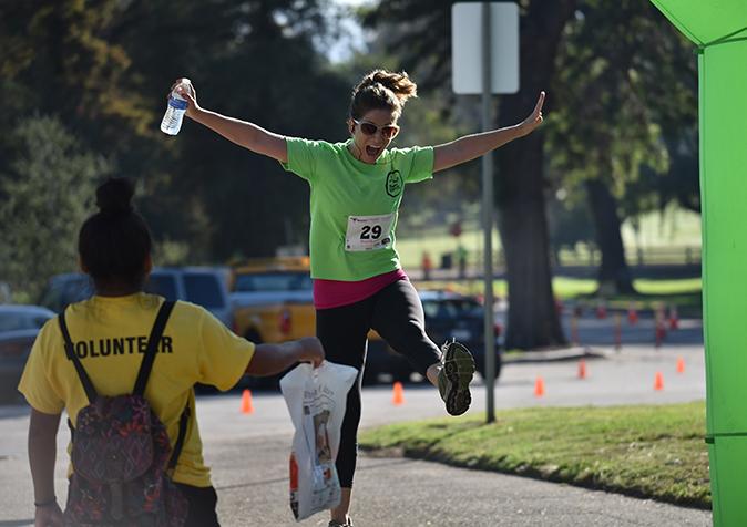 ally-jumping-at-finish-line-photo-credit-joan-birch-zimmerman